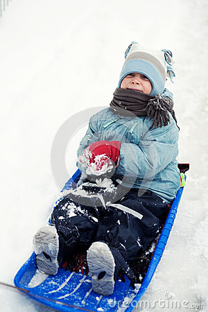 Happy child on sled