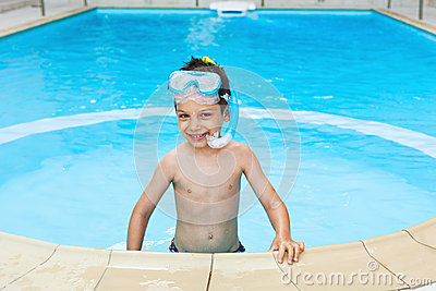 Happy child snorkeler in pool