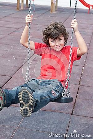 Happy child on the swing