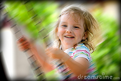 Happy child on swing