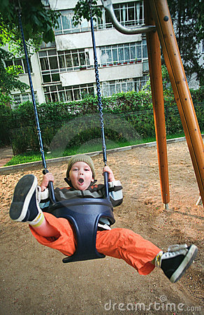 Happy child swinging