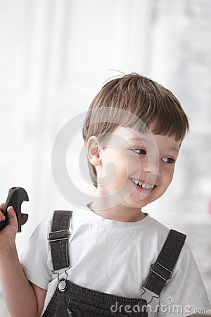 Happy child with tool