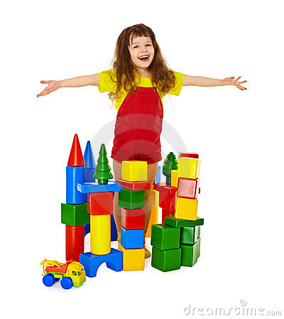 Happy child in a toy castle