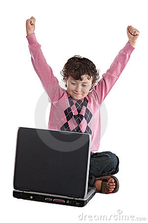 Happy child winner sitting with a laptop