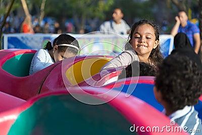Happy Children at Amusement Park