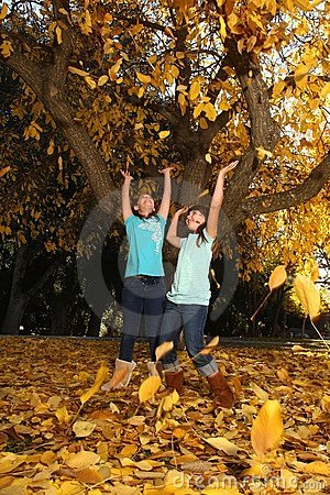 Happy Children With Colorful Fall Leaves Outdoors