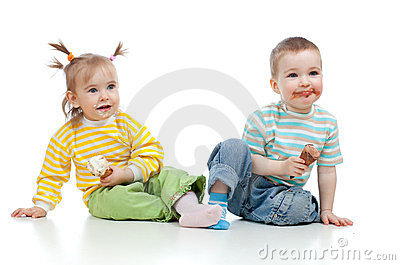 Happy children girl and boy with ice cream