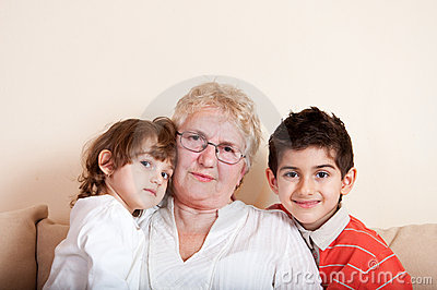 Happy children with grandmother