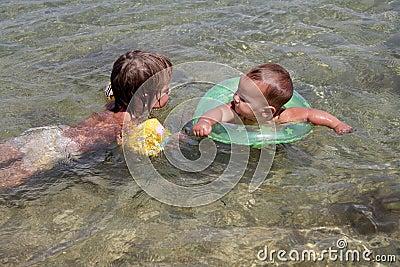 Happy children having fun in water