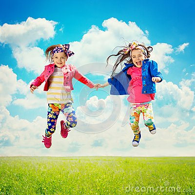 Free Happy Children Jumping On The Spring Field Stock Photo - 40810640