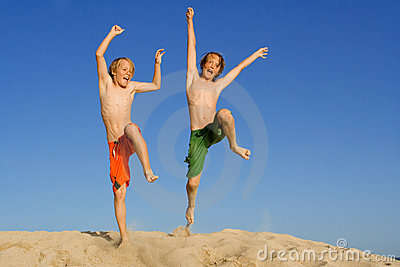 Happy children or kids jumping