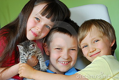 Happy children with kitten