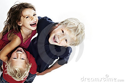 Happy children laughing and looking up