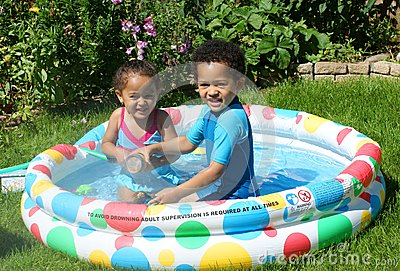 Happy children in paddling pool royalty free stock for Best children s paddling pool