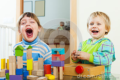 Happy children playing in home Stock Photo