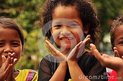 Happy children playing with their hands. Editorial Stock Image