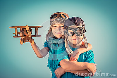 http://thumbs.dreamstime.com/x/happy-children-playing-toy-airplane-kids-vintage-wooden-outdoors-portrait-against-summer-sky-background-travel-freedom-49598001.jpg
