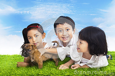 Happy children with puppy
