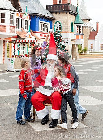 Happy Children And Santa Claus