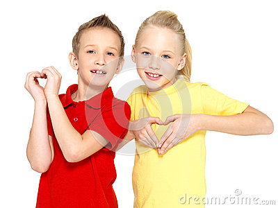 Happy children with a sign of heart shape