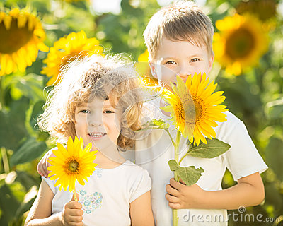 Happy children with sunflower