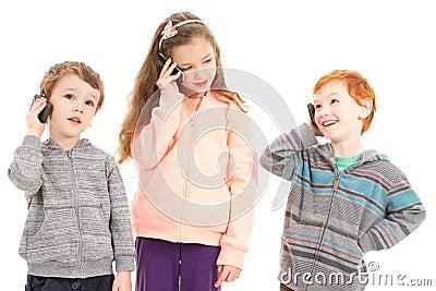 Happy children talking on mobile phones