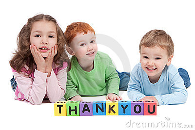 Happy children with thankyou kids letter blocks