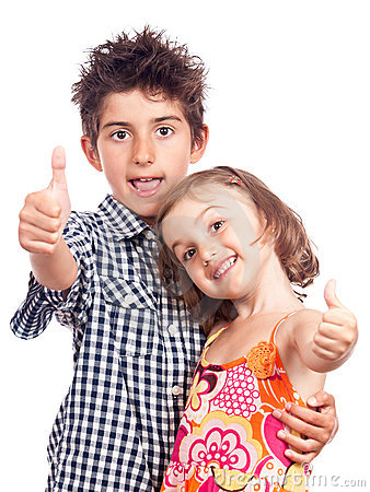 Happy children with thumbs up success