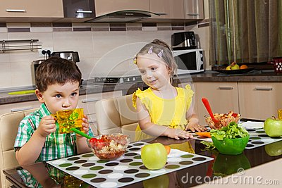 Happy children who eat healthy food