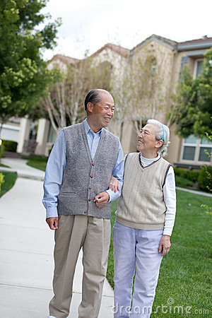 Happy Chinese Elderly Couple Walking
