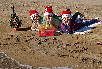 Happy christmas children  on beach