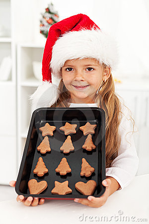 Happy christmas girl baking cookies