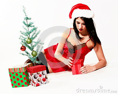 Girl sits by Christmas Tree