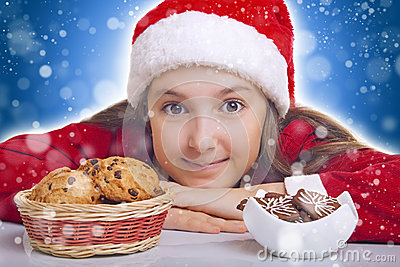 Happy Christmas girl wants to eat cookie
