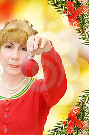 Happy Christmas with woman giving a red bauble