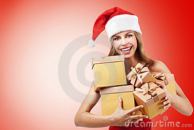 Happy Christmas woman holding gifts
