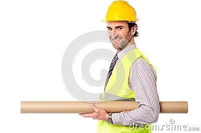 Happy civil engineer holding blueprint