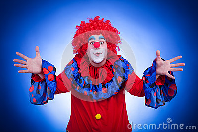Happy clown on blue background