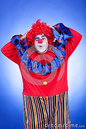 Happy clown men on blue background
