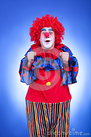 Happy clown in red costume on blue background