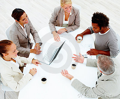 Happy colleagues having a business meeting