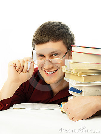 Happy confident student with books