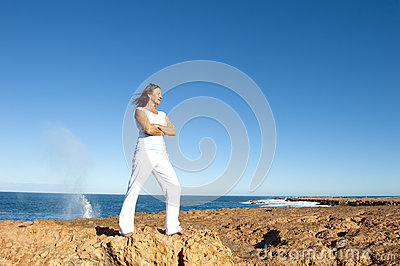 Happy confident woman at ocean background