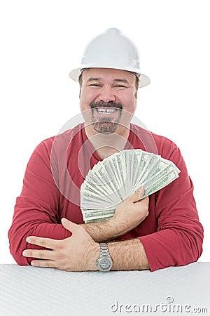 Happy construction worker holding dollar bills