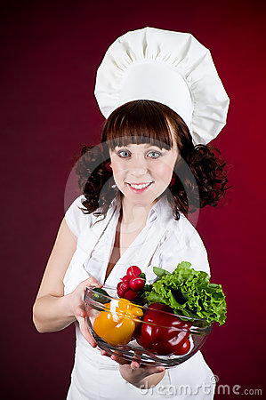 Happy cook woman with vegetables