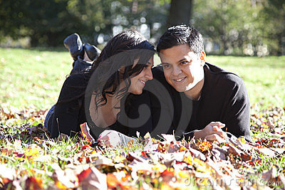 Happy couple in autumn park in love