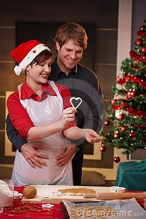 Happy couple baking christmas cake