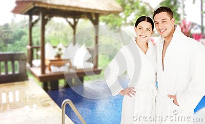 Happy couple in bathrobes over spa hotel resort stock for Couples spa weekend getaway