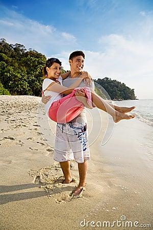 Happy couple on a beautiful beach