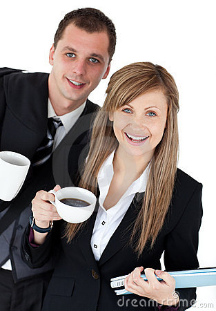 Happy couple of business holding a coup smiling